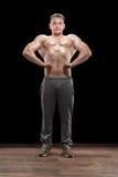 W studiu młody bodybuilder Obrazy Royalty Free