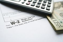 W-2 Tax Form With Pen & Calculator High Quality