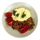 Wątróbka, grula i pomidor przy talerzem, Obrazy Royalty Free