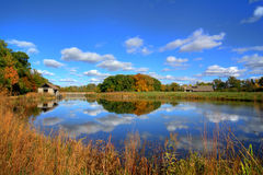W.W. Knight Nature Preserve. Beautiful autumn scene at a tranquil fishing pond in Ohio. The pond features a rustic shelter house. Located in the W.W. Knight Stock Image