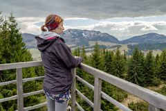 Woman looking from lookout. Woman and lookout on hill Susava in village Velke Borove, Slovakia royalty free stock images