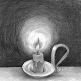 Świeczka w zmroku Obrazy Royalty Free