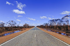 WA Bushfire road sky Stock Photography