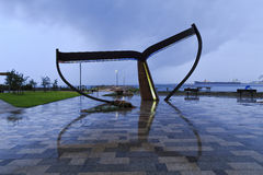 WA Esperance Whale Tail. Esperance town tourism monument of whale tail which is wet due to rain around sunset Stock Photo