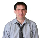 Waaaah!. Businessman with tie undone, crying royalty free stock image