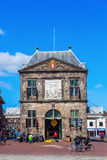 The Waag in Gouda, The Netherlands. Gouda, Netherlands - April 20, 2016: The Waag with unidentified people. It was built in 1667 and was used for weighing goods Royalty Free Stock Photo