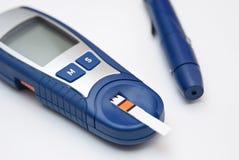 Waagerecht ausgerichtete Blutprobe der Glukose Lizenzfreie Stockfotografie