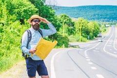 Waar indien ik ga Expeditor die kant van de kaart van de wereldrichting zoeken De Expeditor backpacker kaart kijkt richting stock fotografie