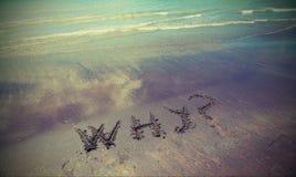 Waarom tekst op het zand royalty-vrije stock foto