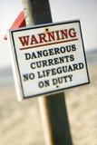 Waarschuwingssein bij het strand Stock Foto