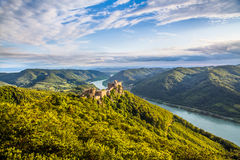 Wachau landscape with castle ruin and Danube river at sunset, Austria Stock Image