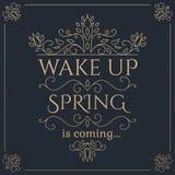 Wachen Sie Frühling ist kommende goldene Beschriftung auf Stockfoto