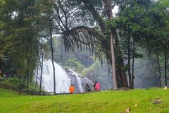 Wachirathan Waterfall with the waterfall and tourist in nature background on December 29, 2017, in Chiang Mai Thailand. Chiang Mai - December 29: Wachirathan stock photos