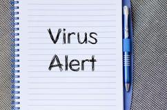 Wachsames Textkonzept des Virus auf Notizbuch Stockbild