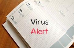 Wachsames Textkonzept des Virus auf Notizbuch Lizenzfreies Stockbild