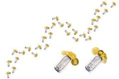 Wachsendes Diagramm gemacht vom silbernen Ziegelstein und von den goldenen Münzen Stockbild
