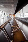 Wachtend gebied in luchthaven stock afbeeldingen