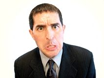 Wacky Businessman. Businessman pulling a funny face royalty free stock image