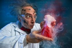 Wacky scientist with explosive experiment royalty free stock images