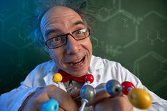 Wacky scientist with molecular structure model. Scientist with wacky smile holding molecular structure model royalty free stock images