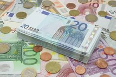 Wad of bills. Wad of twenty dollars on a background full of money stock image