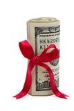 Wad des Bargeldes mit rotem Bogen Lizenzfreies Stockfoto