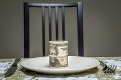 Wad of dollars served on plate Royalty Free Stock Photos