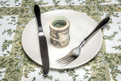 Wad of dollars served on plate Stock Image