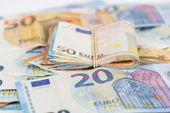 Wad of euro cash bills banknotes. Wad of euro bills banknotes cash on table Royalty Free Stock Photography