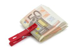 Wad of fifty euros bills. Wad of fifty euro banknotes on a white background royalty free stock photography