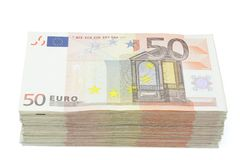 Wad of fifty euros bills. Wad of fifty euro banknotes on a white background stock photography