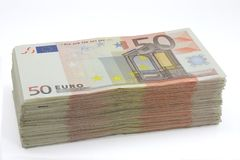 Wad of fifty euros bills. Wad of fifty euro banknotes on a white background stock images