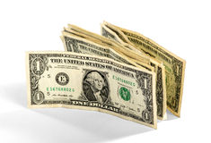 Wad of one UD dollar bills standing upright. Wad of used one UD dollar bills standing upright balance against each other over a white background for a financial Stock Photography
