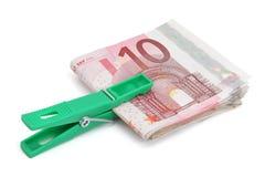 Wad of ten euros bills. Wad of ten euros banknotes on a white background stock photos