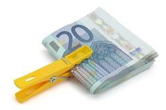Wad of twenty euros bills. Wad of twenty euros on a white background royalty free stock photos