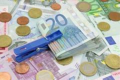 Wad of twenty euros bills. Wad of twenty dollars on a background full of money stock photography