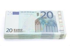 Wad of twenty euros bills. On white background stock photos