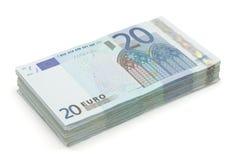 Wad of twenty euros bills. Wad of twenty euros on a white background royalty free stock images