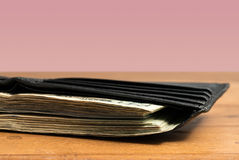 Wad of US dollar bills in black wallet on table Royalty Free Stock Photography