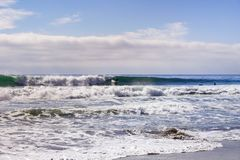 Waddell Beach and good surfing waves on a sunny day, Pacific Ocean coastline, Davenport, California stock image