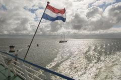 Wadden Sea with Dutch flag as seen from the ferry Stock Photo