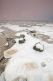 The Wadden Sea with snow and ice. Photographed in the evening Stock Photos