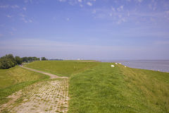 Waddensea with dike in the Nethertlands Stock Photo