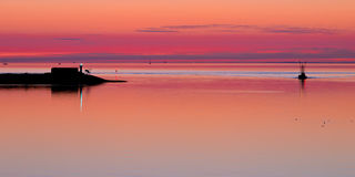 Waddensea Sunset with Pier Stock Photography