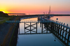 Waddensea Sunset with Pier Stock Photo