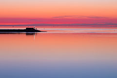 Waddensea Sunset with Pier Royalty Free Stock Photo