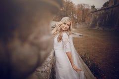 Wadding day HD. Bride walking in golden autumn nature wedding Stock Photos