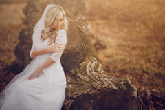 Wadding day HD. Bride walking in golden autumn nature wedding Royalty Free Stock Photography