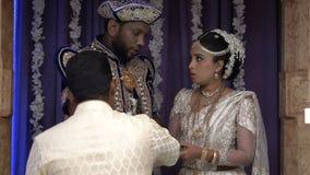 Wadduwa, Sri Lanka - May 11, 2018: Beautiful wedding ceremony in Sri Lanka. Newlyweds in traditional costumes stand under the arch stock footage