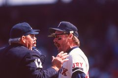 Wade Boggs argues with an umpire. Red Sox 3B Wade Boggs argues with an umpire. Image taken from a color slide stock photo